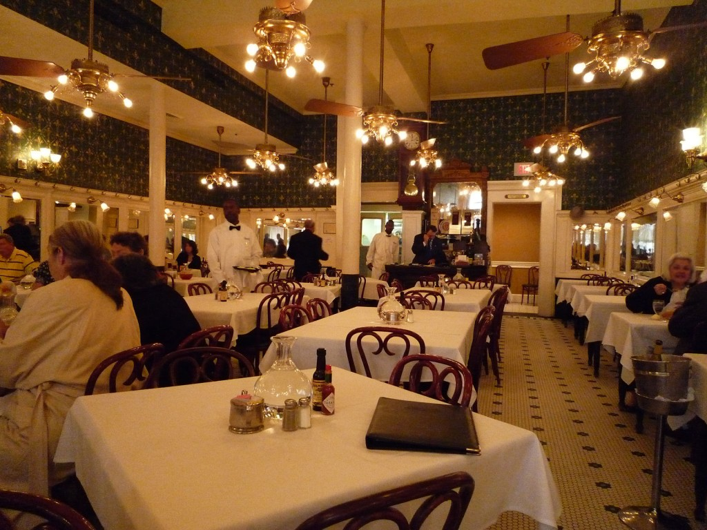 The main dining room of Galatoire's, a noted restaurant in New Orleans | © Bobak Ha'Eri/WikiCommons