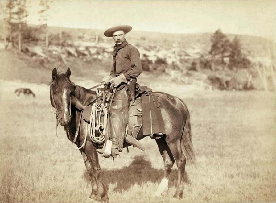 A cowboy, circa 1887, wearing shotgun style chaps | Public Domain/Wikicommons