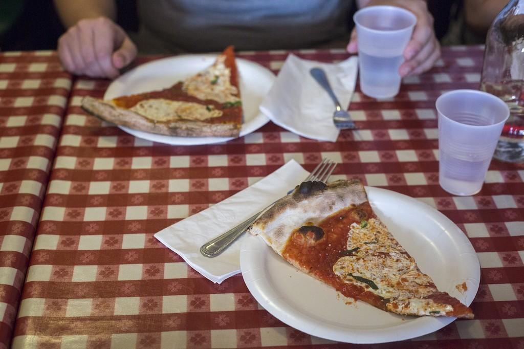 A slice of pizza on Scott's Pizza Tour | © Dana deLaski