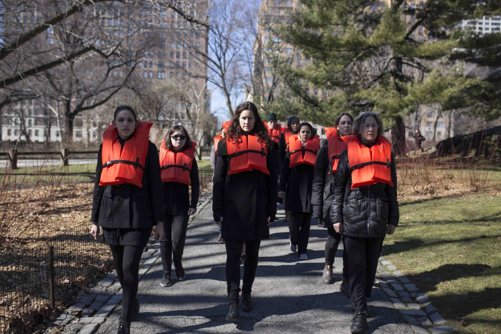 In the Greek Georgia Lale's #OrangeVest performance, people dressed in black and a orange life vest keep popping up along the parcours | © George Xourafas/courtesy of Nuit Blanche