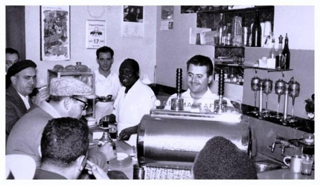 Patrons of the Caffè Triestina in Tripoli enjoying quick shots of espresso at the bar in the 1960's. |Source: Hani Fteita and Aldo Cicero/Tumblr