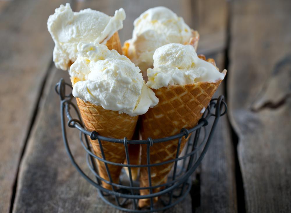 Vanilla ice cream on wooden surface ©Diana Taliun / Shutterstock