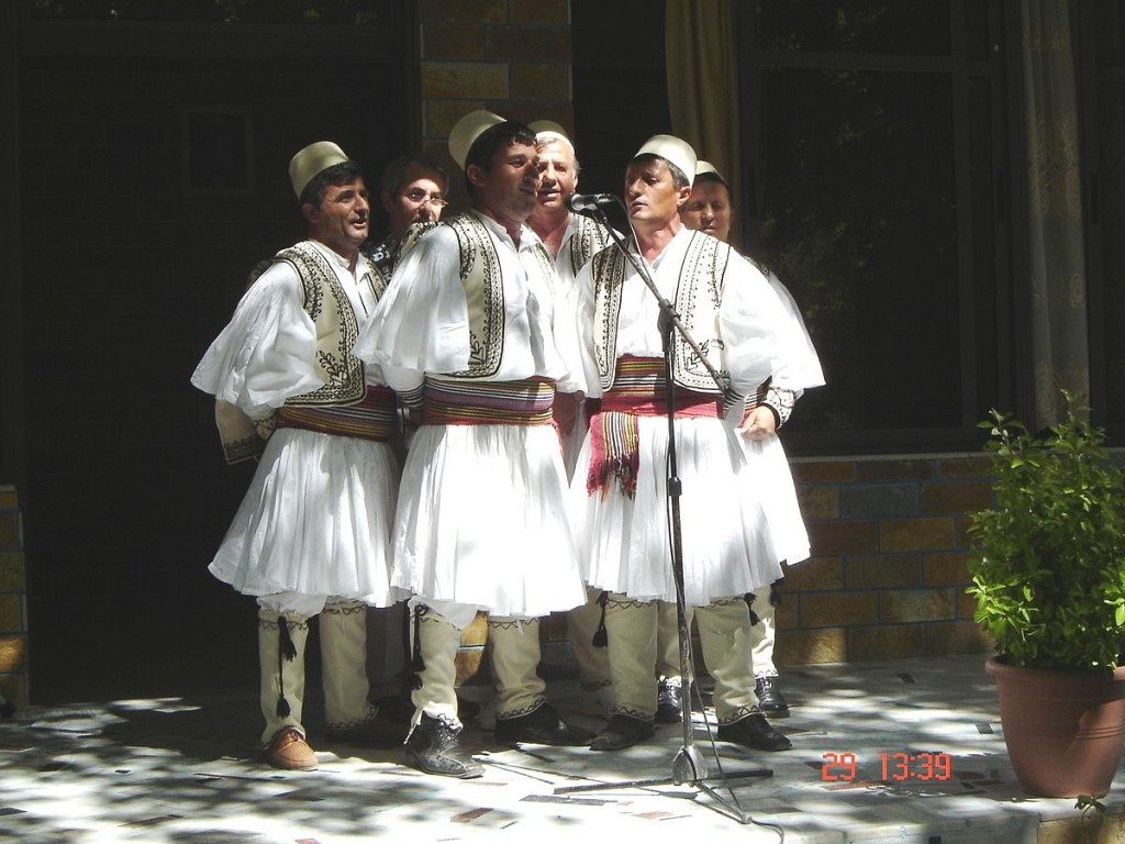 Albanian polyphonic group from Skrapar wearing qeleshe and fustanella |©Gerd 72/WikiCommons