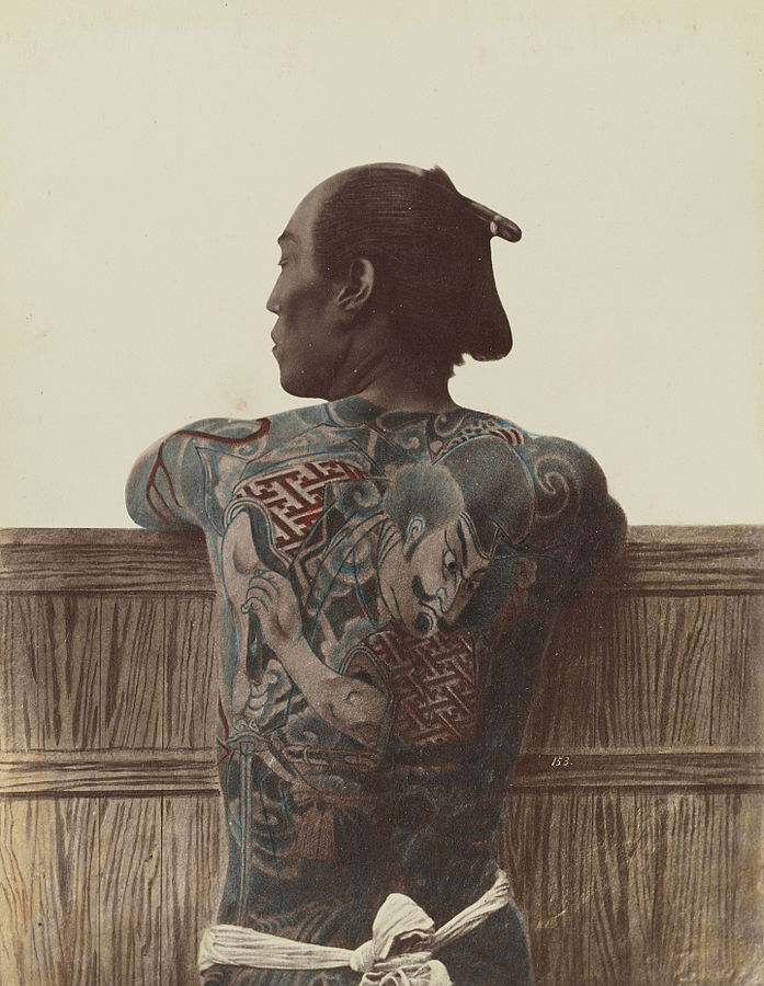 Tattooed man, late 1800s. Color appears to have been added to the photo | © Kusakabe Kimbei/WikiCommons