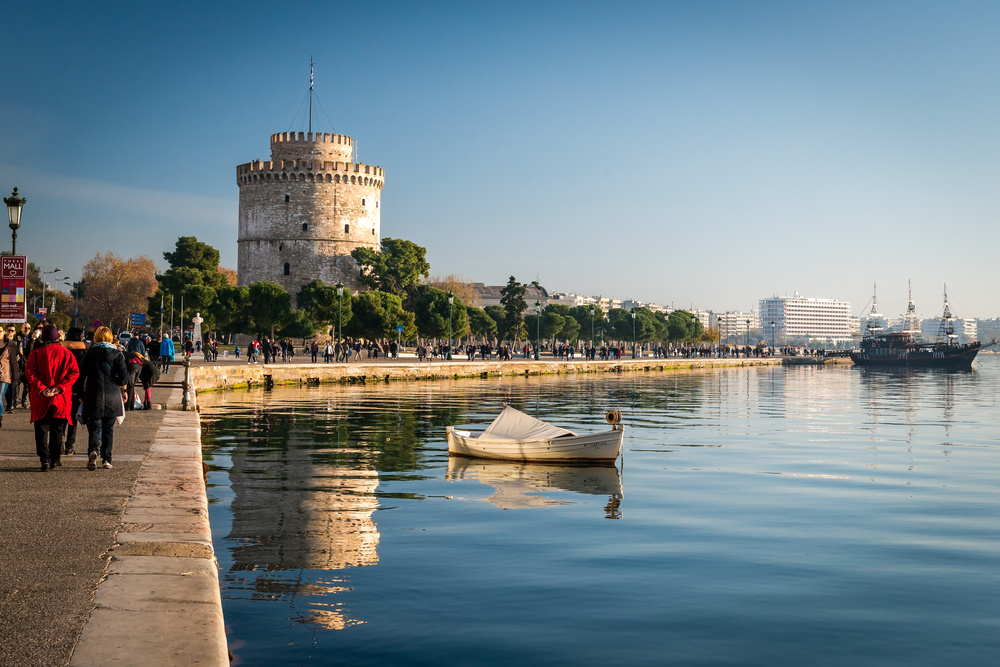 Thessaloniki next to the white tower which which once guarded the eastern end of the city's sea walls ©Aivita Arika / Shutterstock