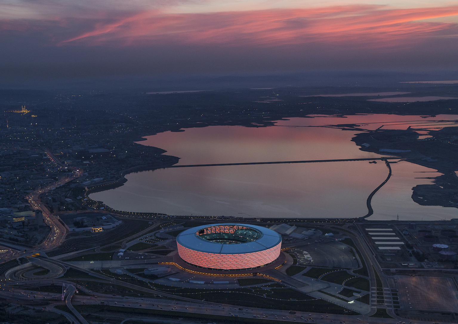 the best architectural photo in the world is of a london reservoir baku national stadium by heerim architects in collaboration with rossetti azerbaijan victor romero