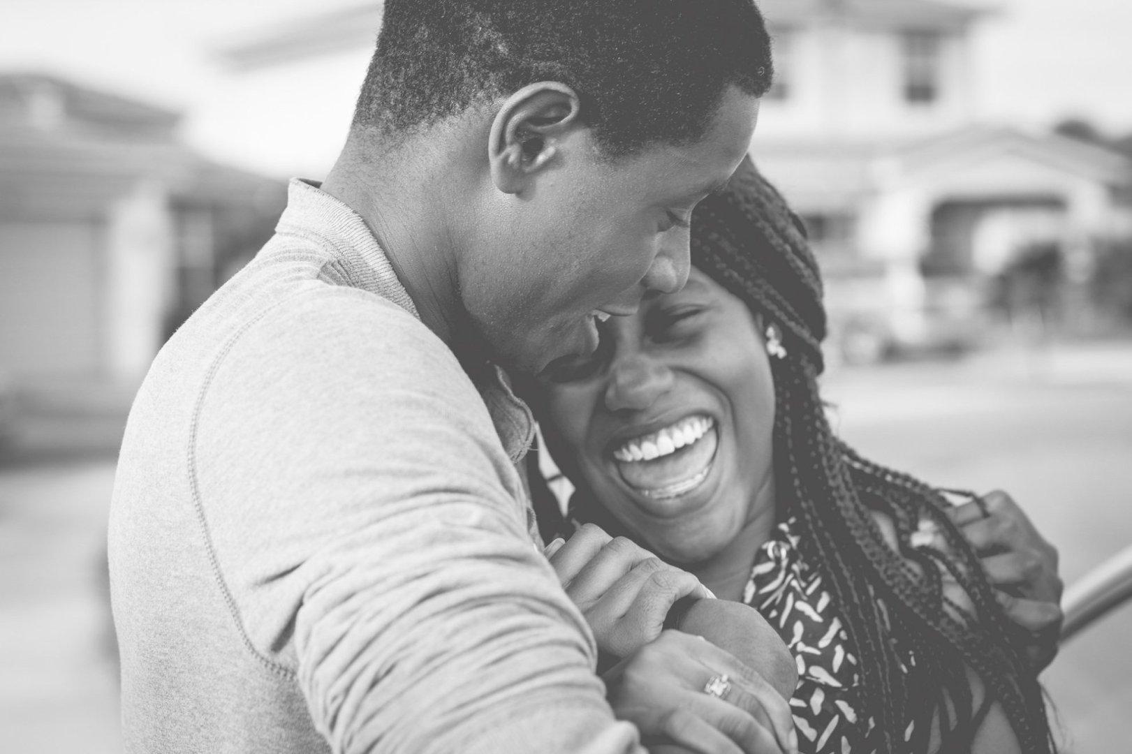 Happy couple laughing © William Stitt/Unsplash
