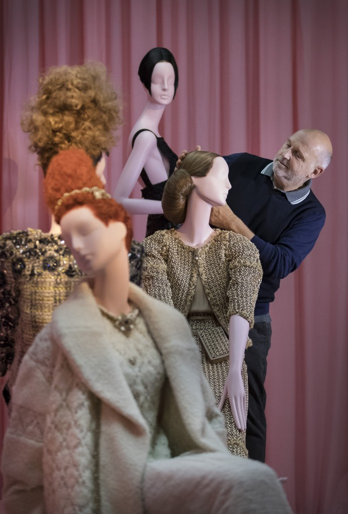 Sam McKnight puts the finishing touches to a display of mannequins highlighting his work for Chanel. Photo: Peter Macdiarmid