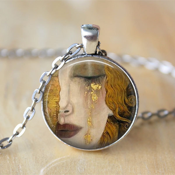 Gustav Klimt 'Crying Woman' necklace, via Etsy
