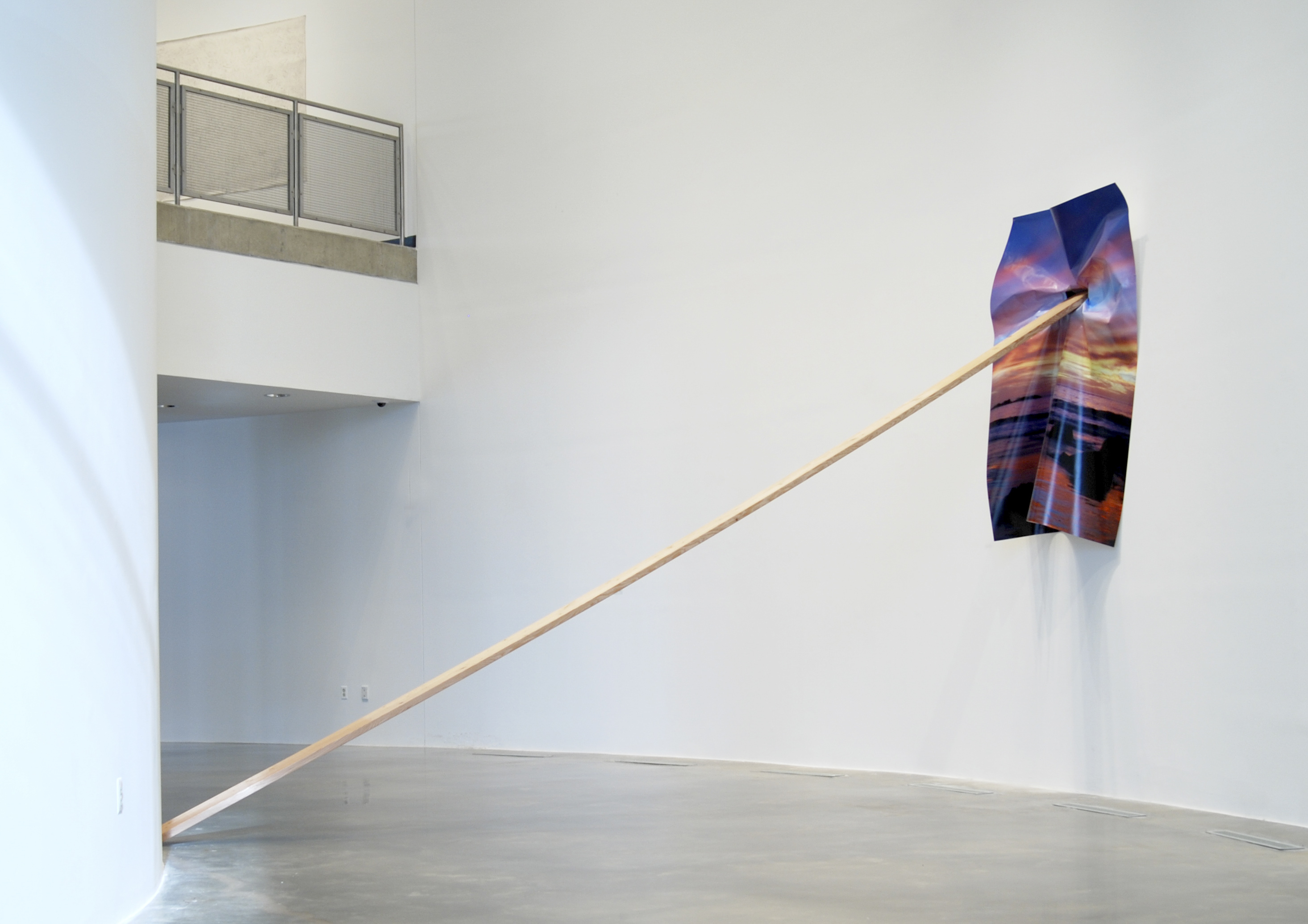 California Sunset Lean, 2014 digital print on vinyl, wood, hole in wall Installation approx 12' x 6' x 18'. Print size: 6' x 8' Installation view of Ad Infinitum, American University Museum at the Katzen Arts Center, Washington, DC. | Courtesy of Letha Wilson