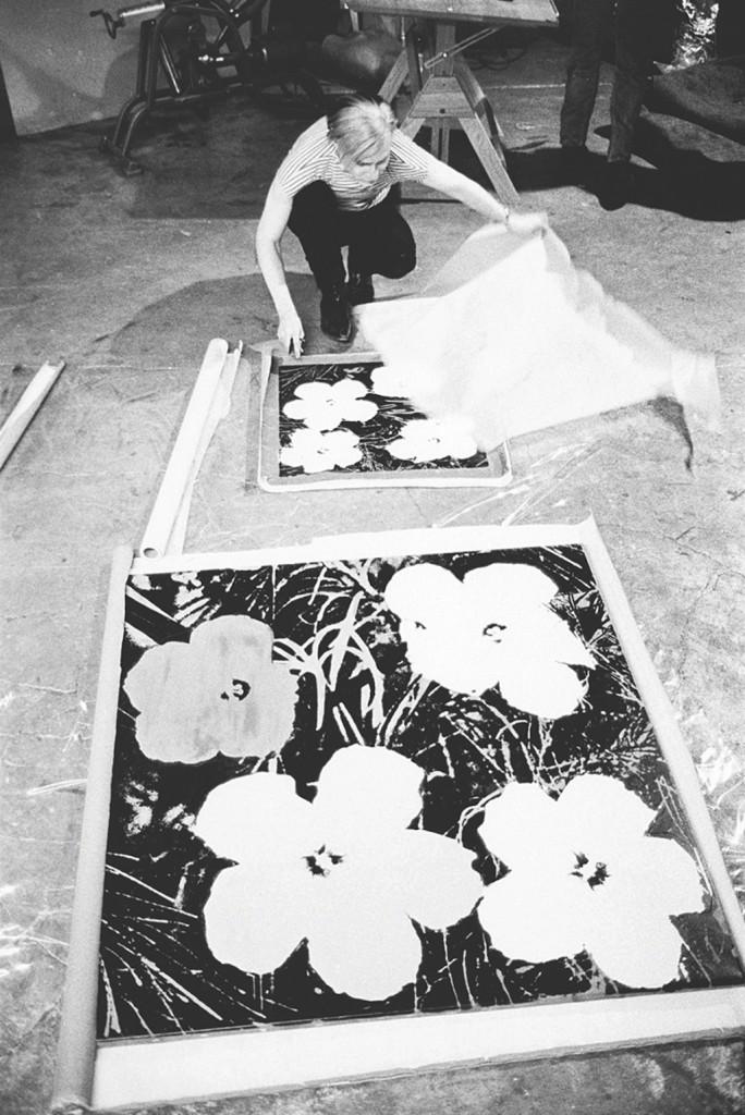 Stephen Shore: Andy Warhol silk-screening Flowers, 1965-7 (page 46). | © Stephen Shore