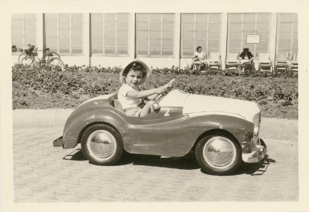 Circa 1960: Belgian kid in a toy car | jinterwasflickr