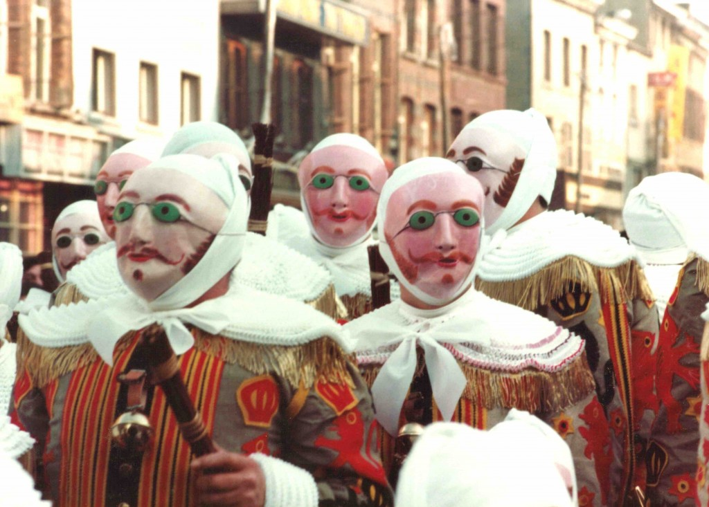 The Gilles in their wax masks with green goggles and fiery moustaches | © Marie-Claire/Wikimedia Commons