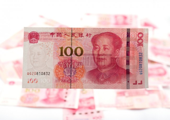 A 100 yuan note. Roughly equivalent to £10, it is the highest denomination of Chinese Currency. | © Joesayhello/Shutterstock