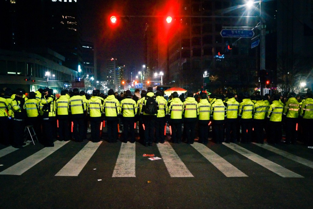 Policemen stand guard during New Year's Eve celebrations | © Chris Marchant / Flickr