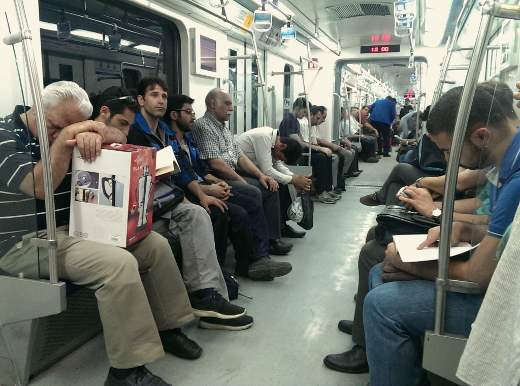 Commuters take a nap on the metro   © Kamyar Adl / Flickr