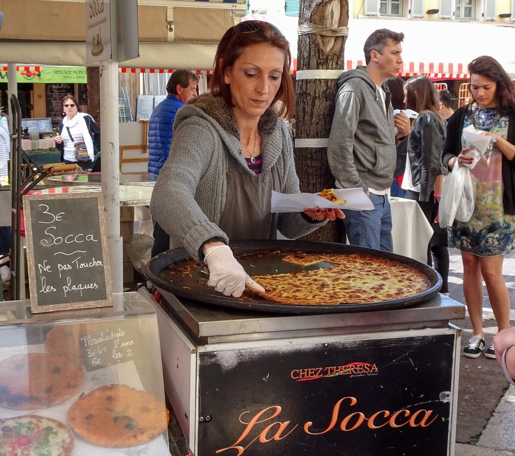 "A visit to Nice should include the local delicacy of ""socca"" - chickpea pancake