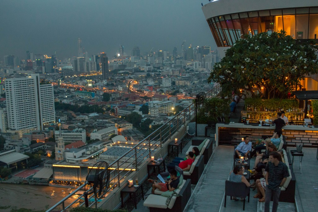The view across the city from one of the Millennium Hilton Bangkok's rooftop restaurants | Courtesy of LWYang/Flickr