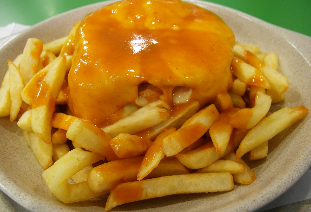 If the francesinha's three meats and array of cheeses isn't enough, serve with a belt-busting side of thick-cut fries | © Yidian Cheow/Flickr