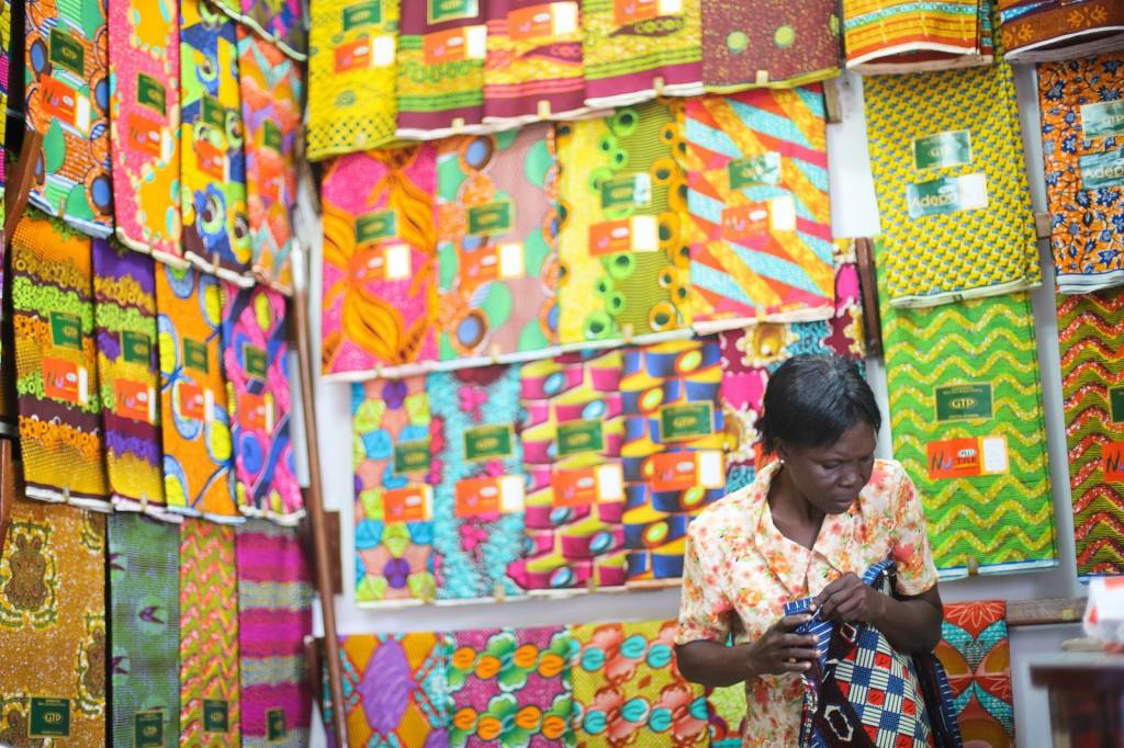 Textiles trader at Makola Market © Yenkasa