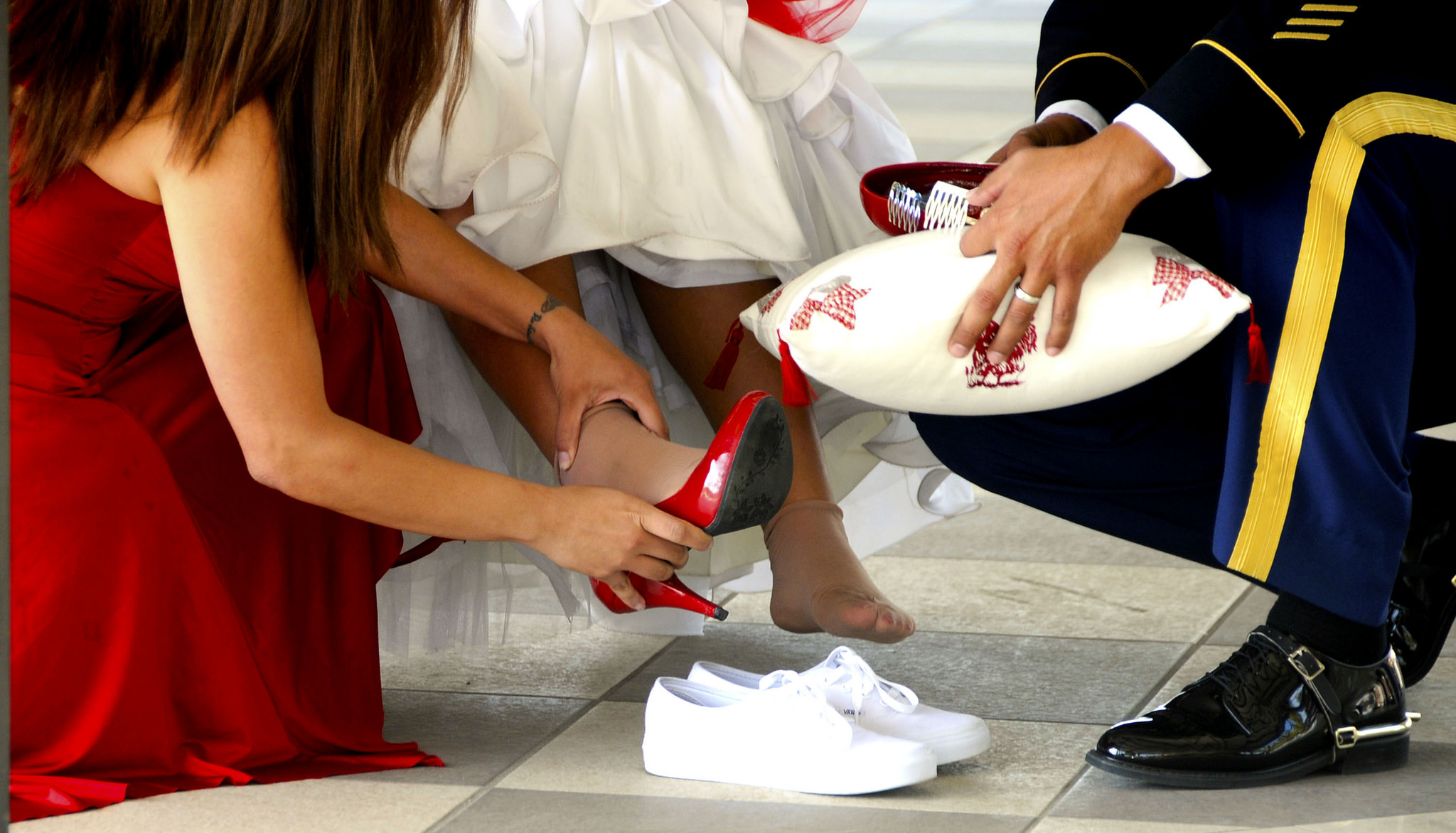 Changing her flats for heels during the quinceañera   © US Army Africa/Flickr