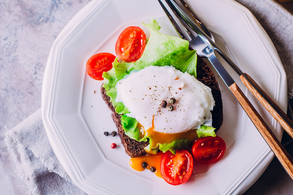 Rye Bread Toast and Poached Egg with Green Salad, Cherry tomato | © AnikonaAnn/Shutterstock
