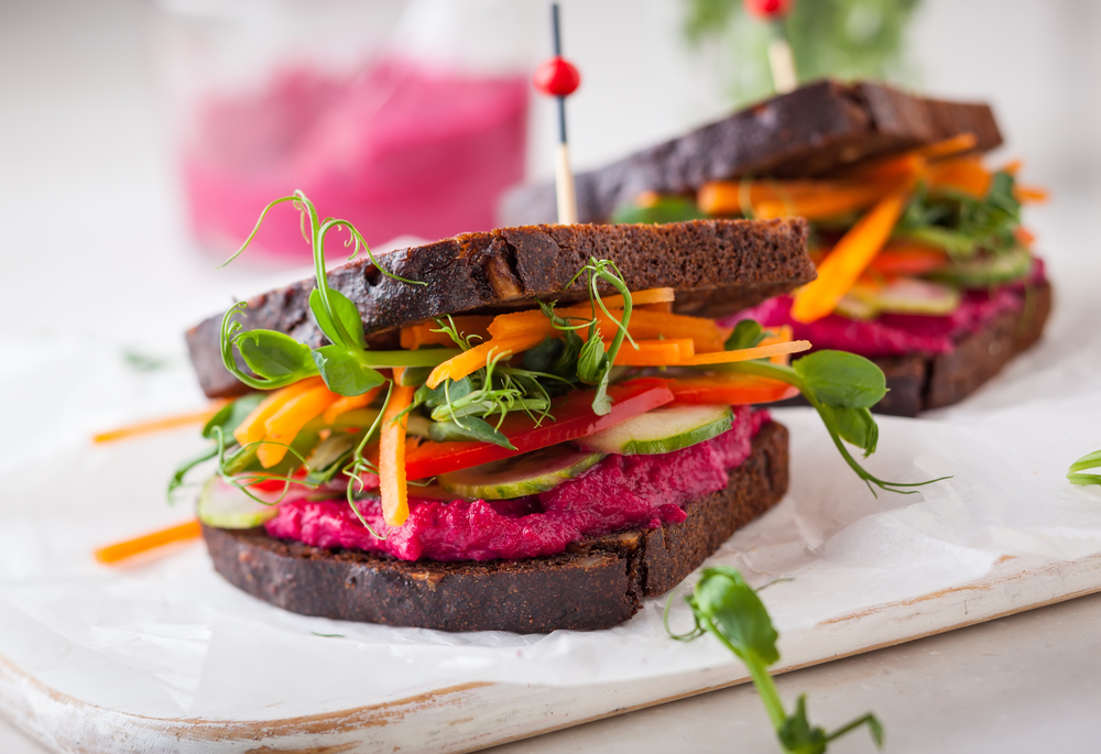 gluten free vegan sandwiches with beet hummus, raw vegetables and sprouts│©sarsmis/Shutterstock