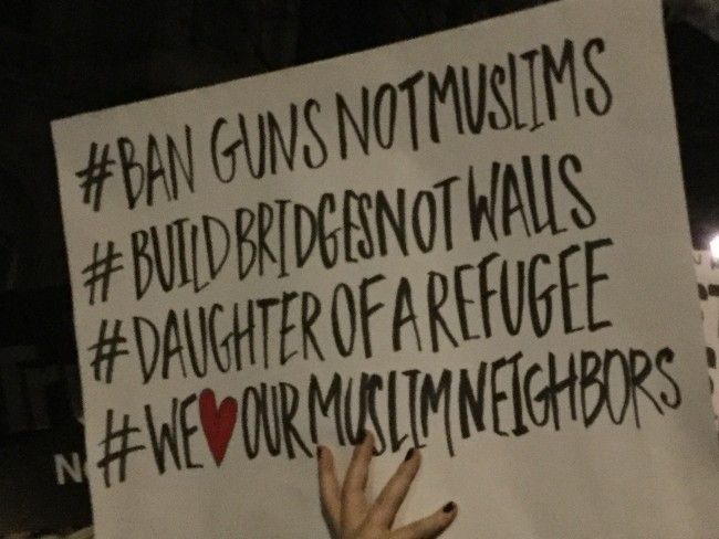 A protester urges peace, unity and compassion | © Ruaidhrí Carroll