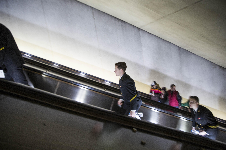 A man in uniform ascends from the L'Enfant Plaza Metro station. | ©Amanda Suarez