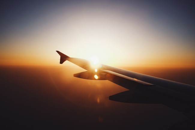 If you don't have a window seat or your neighbor's is closed, take the opportunity to get up and stretch | © Jacky Lo / Unsplash