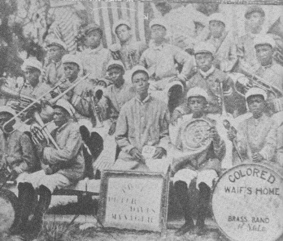 "The arrow at the top of this photo points to Louis Armstrong at the age of 11, a member of the ""Colored Waifs Home"" band/NationalArchieves"