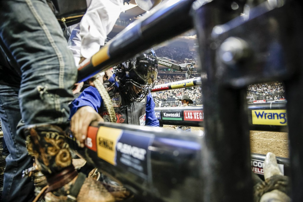 A rider readies in the chute before the gate opens and the ride begins   © Amanda Suarez/Culture Trip