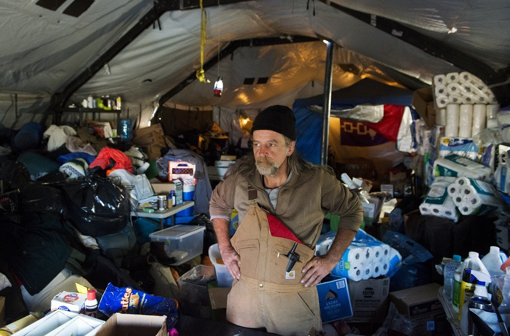 A volunteer at Standing Rock operates the supply tent for fellow protesters
