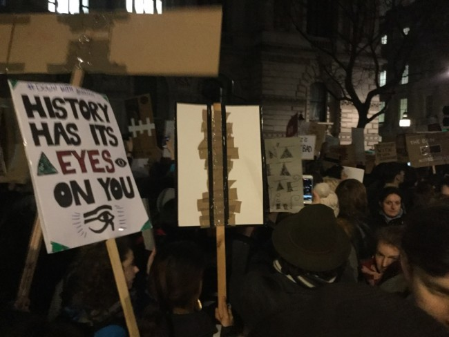 """A protester urges Trump to look at the big picture: """"History has its eyes on you."""" 