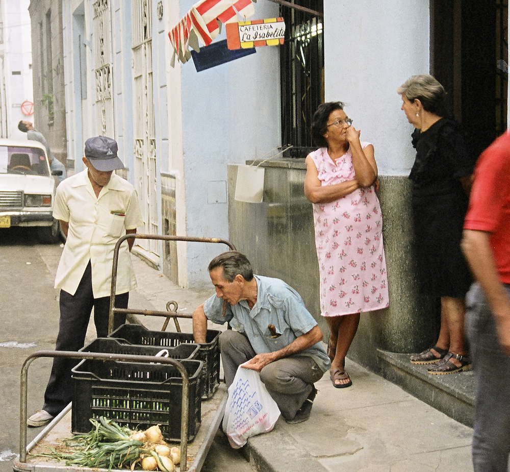 Cuban locals gather on a street corner © Cyndie Burkhardt