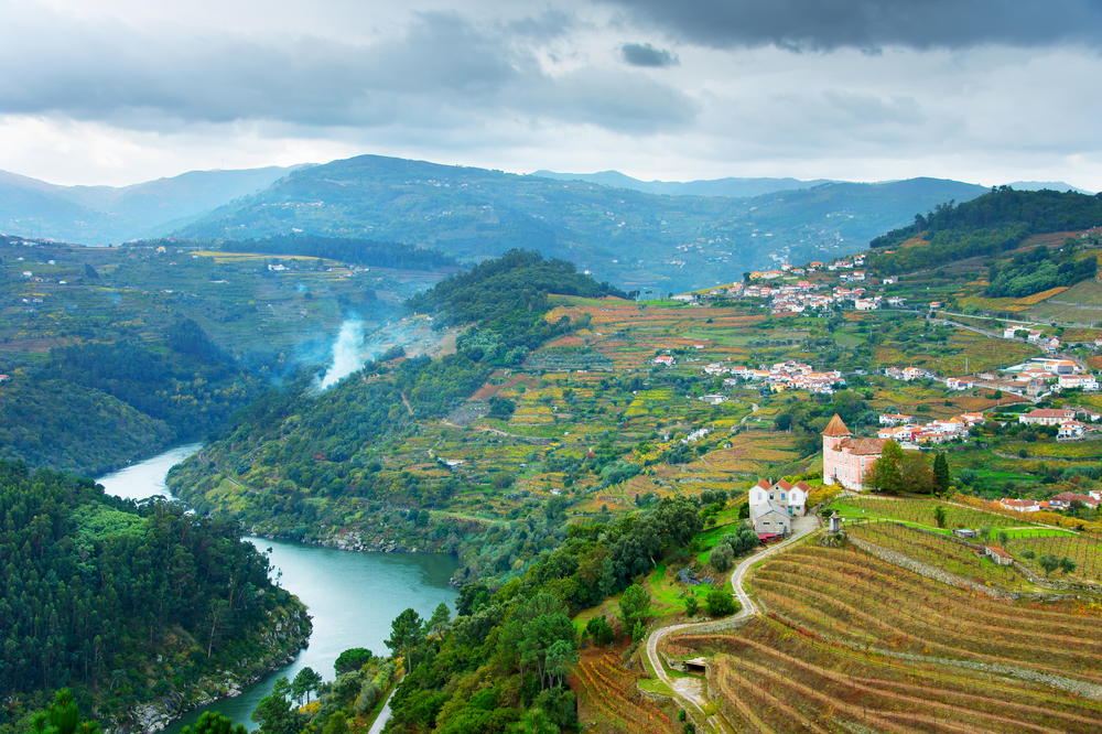 View of Douro river, wineyards and villages on a hills. Portugal | © Joyfull/Shutterstock