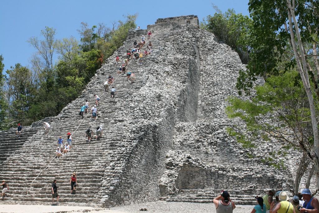 5 Must-Visit Mayan Ruins Near Cancun, Climbing Coba|©Austin Flynn/Flickr