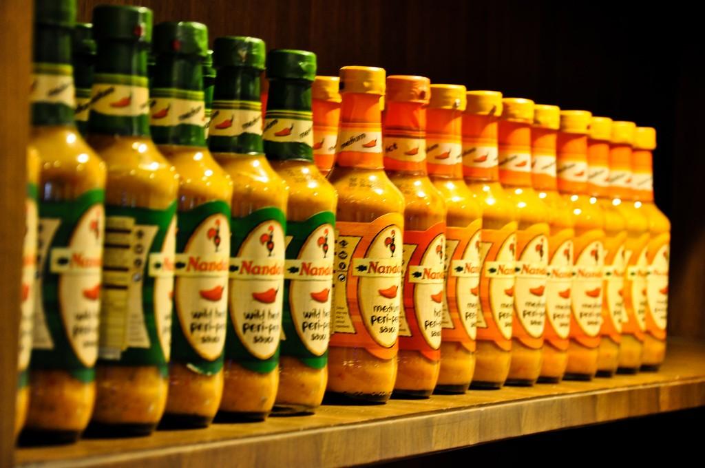 Bottles of Nandos peri peri sauce| © Praveen / Flickr