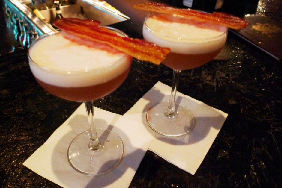 Two cocktails with bacon on them