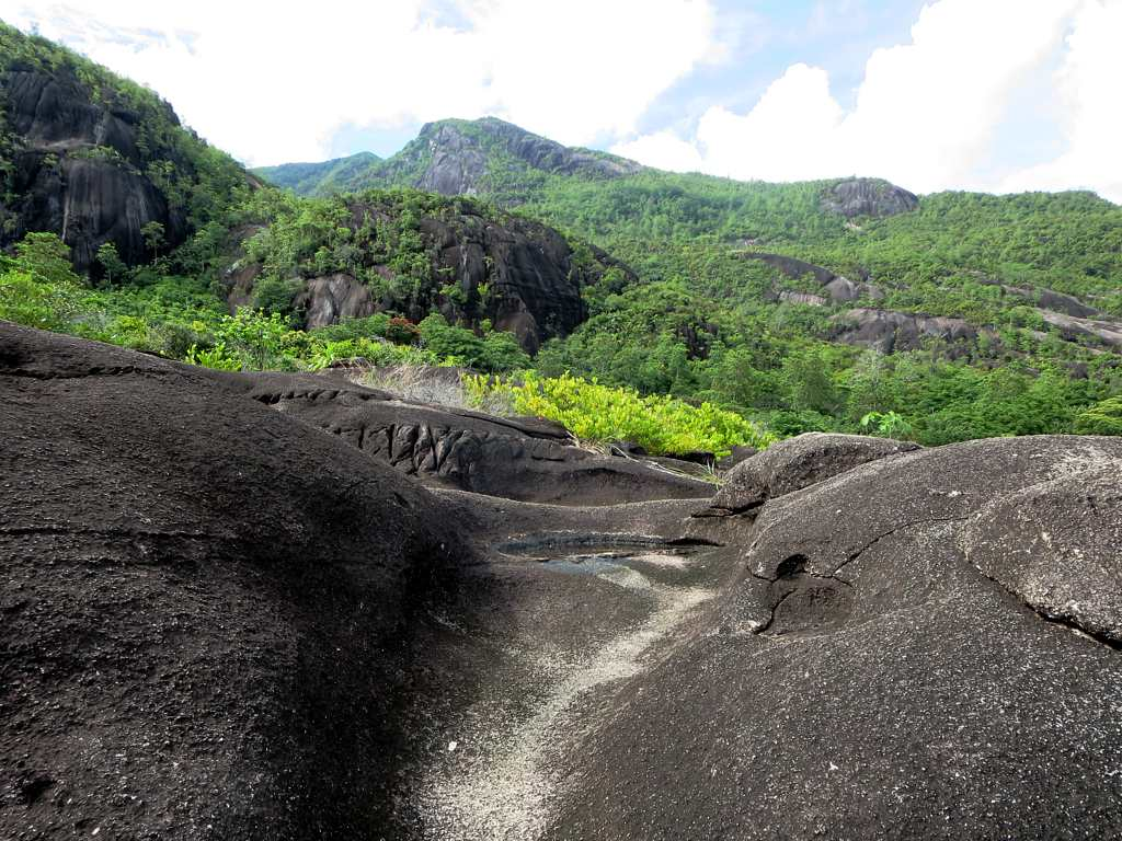 Weathered granite outcrops such as these by the trail to Anse Major on Mahe Island are a characteristic feature of Seychelles. |©david stanley / flickr