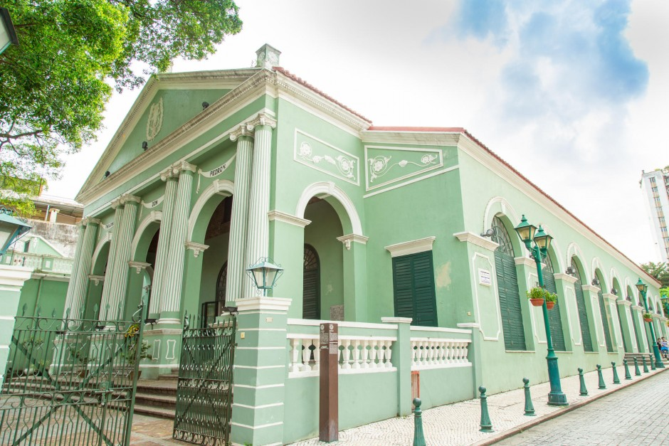 Beautiful mint green exterior of the Dom Pedro V Theatre in Macau