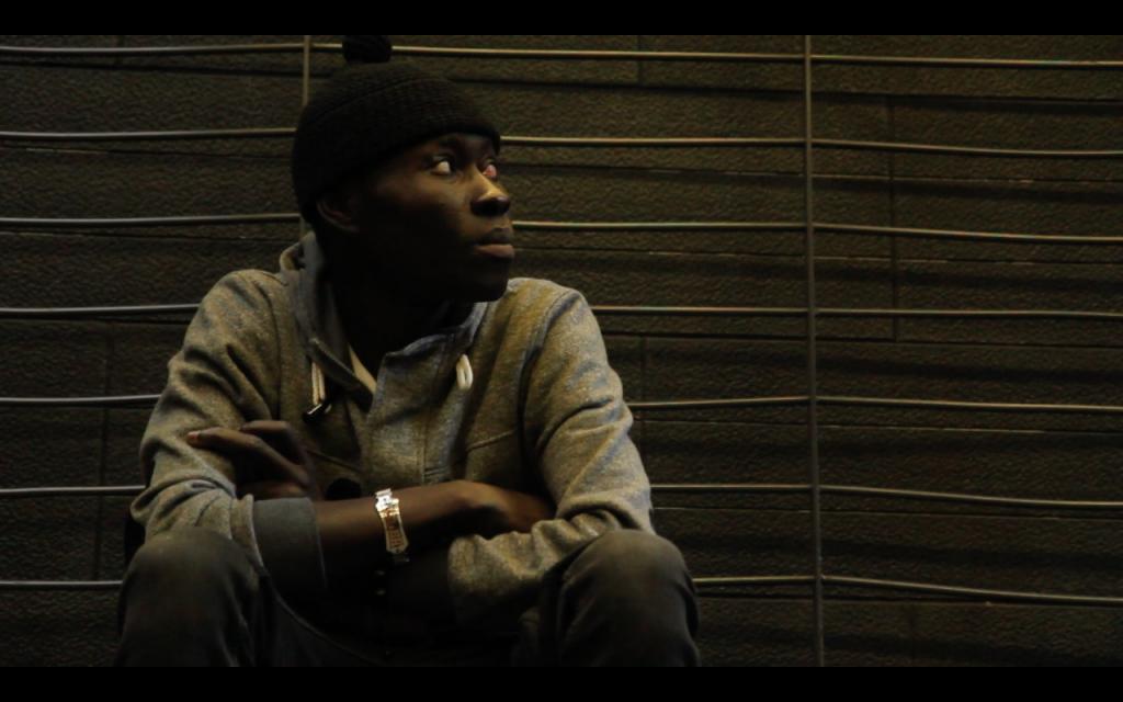 A mantero sitting outsidea metro station, in the film| Courtesy of Otoxo Productions