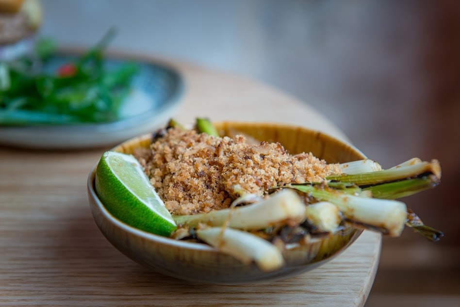 Fried green onions with peanuts and a side of lime at Tel Aviv's Fifi's Asian Food | Yaron Brenner ©, courtesy of Fifi's