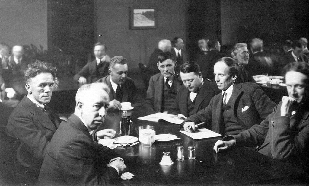 Six of the Group of Seven, plus their friend Barker Fairley, in 1920. From left to right: Frederick Varley, A. Y. Jackson, Lawren Harris, Barker Fairley, Frank Johnston, Arthur Lismer, and J. E. H. MacDonald. | Public Domain