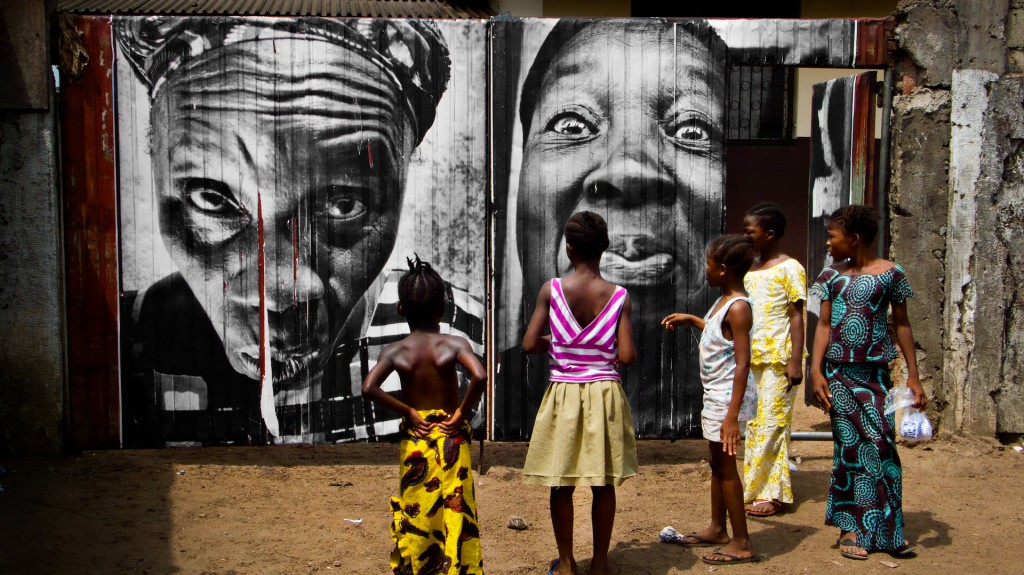 """28 Millimètres : Women Are Heroes, Pasting in Monrovia streets, Liberia"" © JR-ART.NET / Courtesy Gallerie Perrotin"