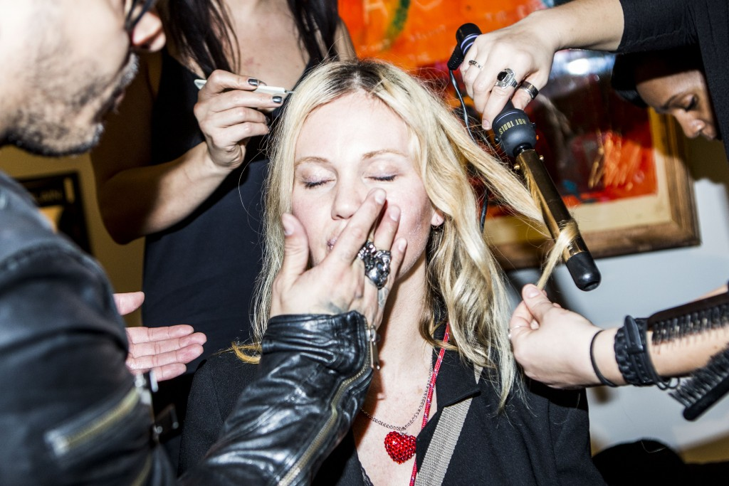 The designer Lindsay Jones gets touched up before the show
