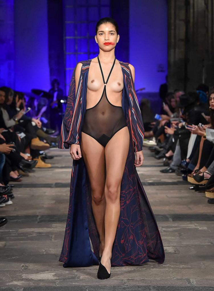 Pregnant glamour model walks the runway naked