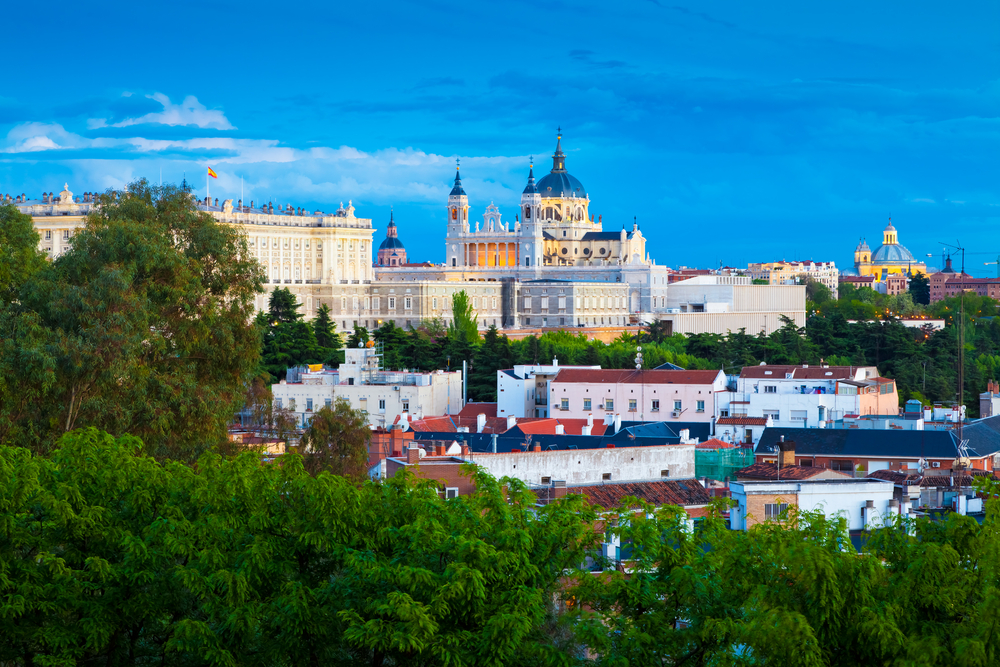 Madrid Skyline at dusk with the Royal Palace and the Almudena Cathedral | © INTERPIXELS/Shutterstock