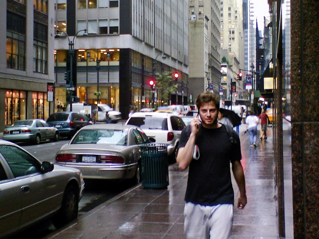 Man talking on the phone while walking in downtown streets Xiang Chen/Flickr