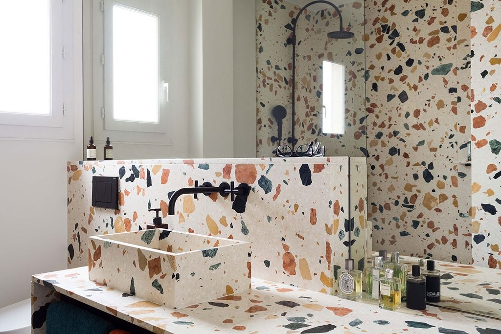 This bathroom in Paris by Dzek has been covered in Max Lamb's Marmoreal terrazzo